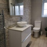 White bathroom suite installation free standing cabinet and tiling by Orbital Kitchens & Bathrooms